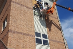 Picture-showing-siding-repair-using-man-lift-by-ace-Junction
