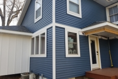 Siding-by-Ace-Denise-showing-vinyl-with-lp-accent-and-vertical-siding